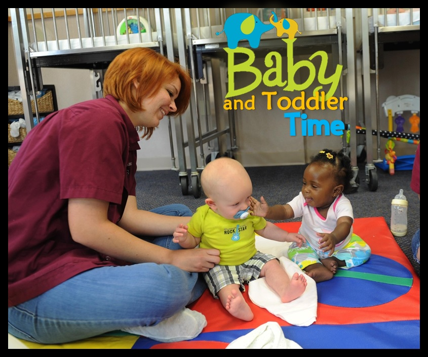 Two babies and caregiver during Baby and Toddler Time